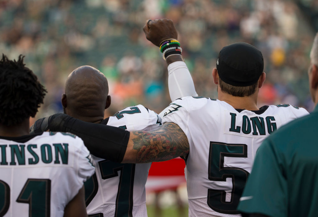 34287fbc91a0b Malcolm Jenkins  27 of the Philadelphia Eagles holds his fist in the air  while Chris