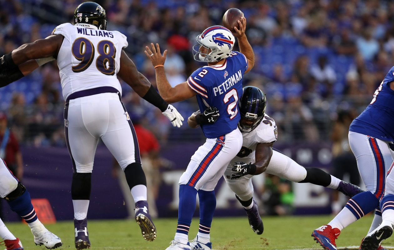 Nathan Peterman is tackled by linebacker Matt Judon as Brandon Williams closes in during a preseason game in 2017. (Photo by Patrick Smith/Getty Images)