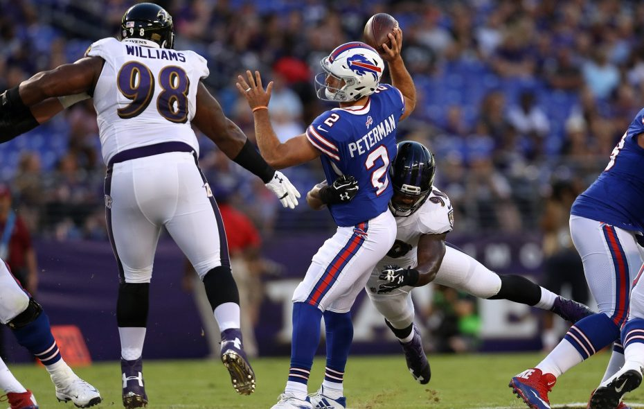 Bills quarterback Nathan Peterman is sacked against the Baltimore Ravens in the team's third preseason game. (Patrick Smith/Getty Images)