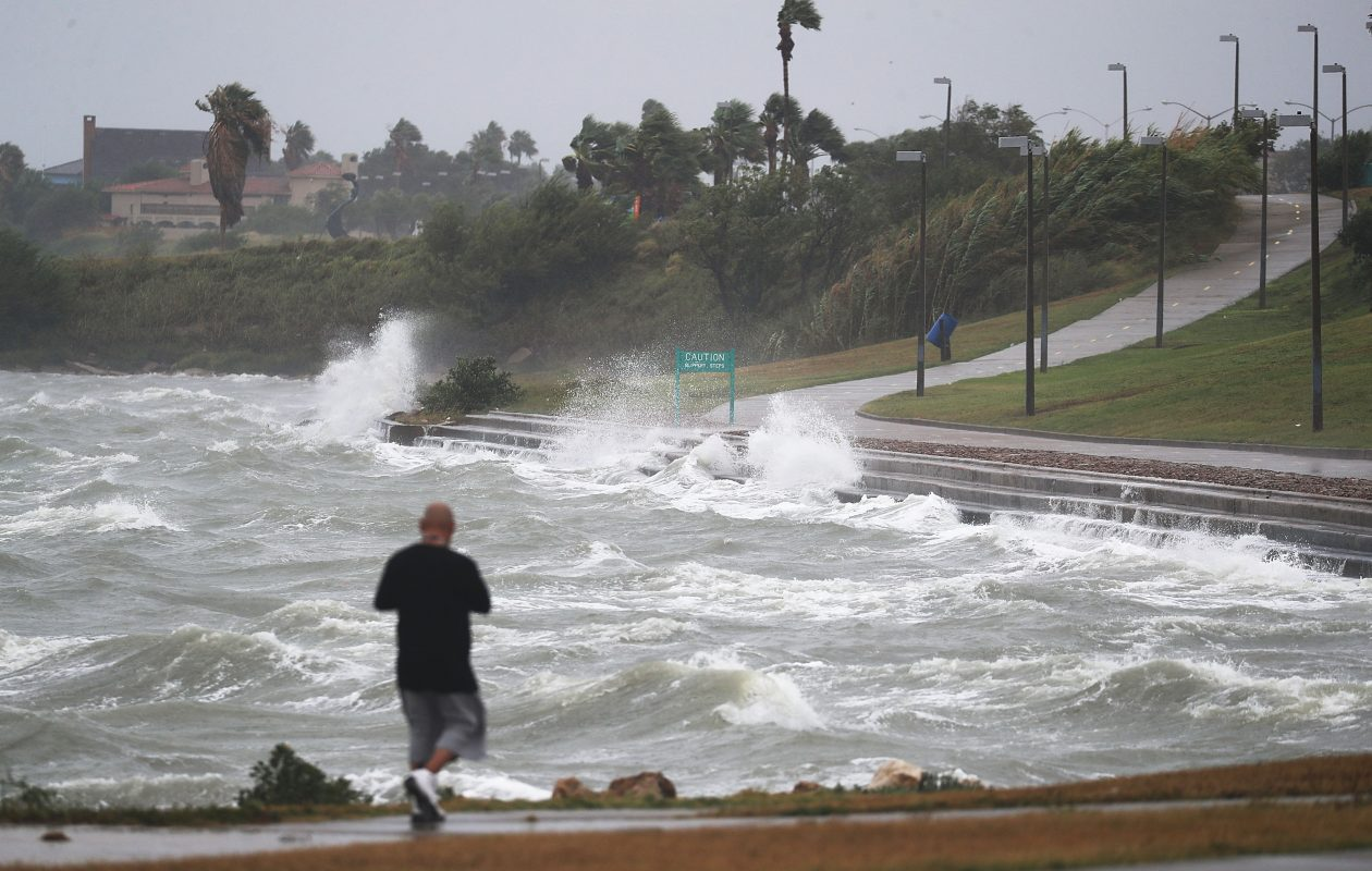 Sal Valerio walks near the bay waters as they churn from approaching Hurricane Harvey on Friday in Corpus Christi, Texas.  Hurricane Harvey has intensified into a hurricane and is aiming for the Texas coast with the potential for up to 3 feet of rain and 125 mph winds.  (Getty Images)