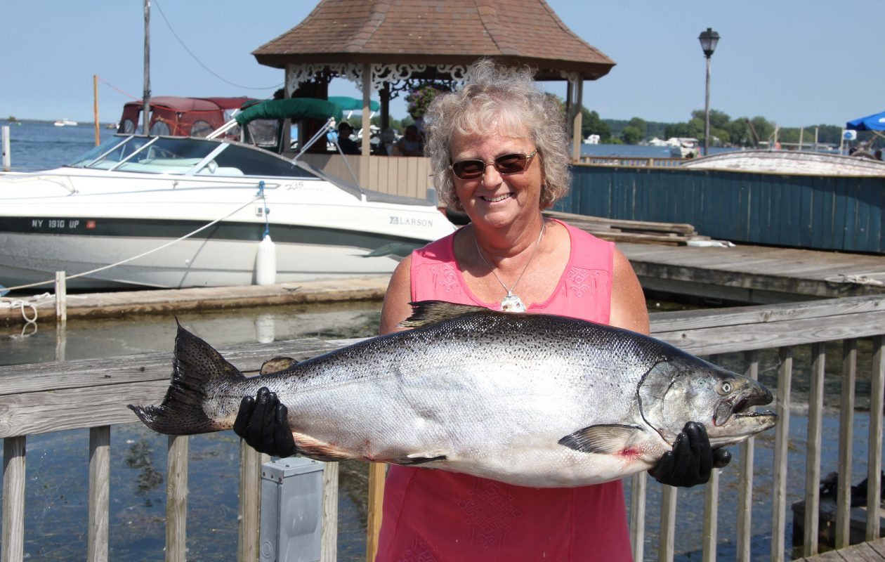 Sandra Brown of Clearfield, Pa., with her grand-prize salmon.