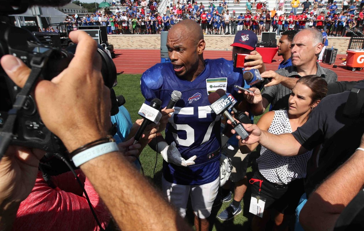 Lorenzo Alexander meets with the media after a training camp practice on Aug. 14, 2017. (James P. McCoy/Buffalo News)