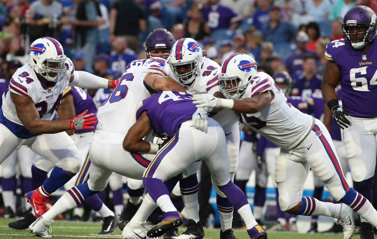 Buffalo Bills defensive end Eddie Yarbrough (75) tackles Minnesota Vikings running back Bishop Sankey (43) in the second quarter. (James P. McCoy/Buffalo News)