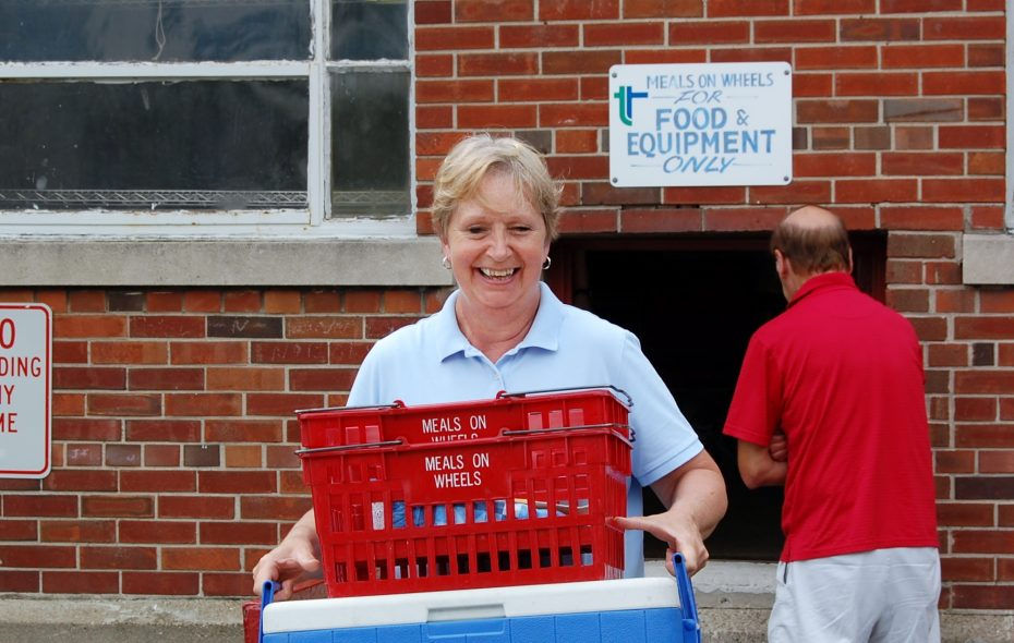 Ken-Ton Meals on Wheels Volunteer carries prepared meals to her car for delivery