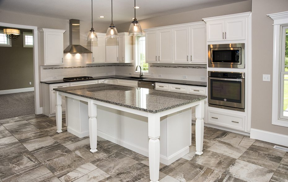 The kitchen is the heart of this home by Grau Builders.