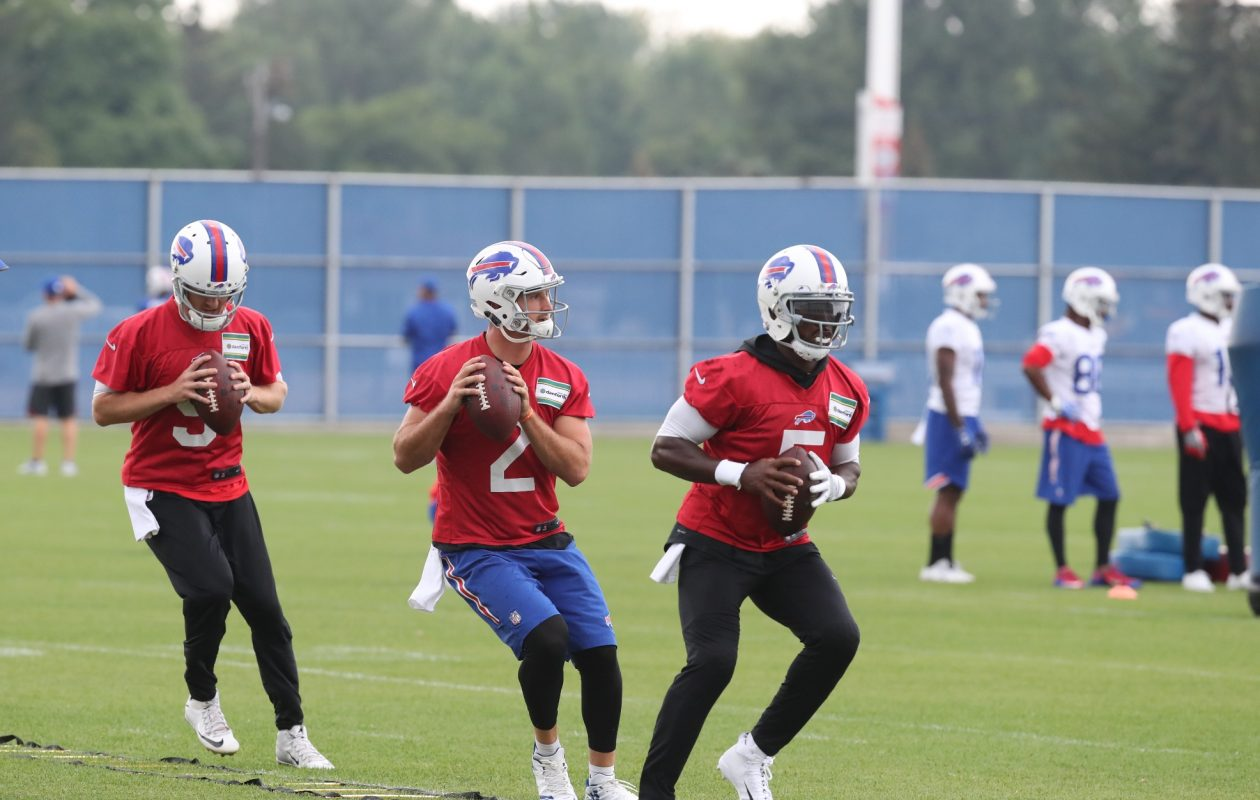 Buffalo Bills quarterbacks T.J. Yates, left, Nathan Peterman and Tyrod Taylor run foot drills during practice Tuesday at AdPro Sports Training Center in Orchard Park.  (James P. McCoy/Buffalo News)