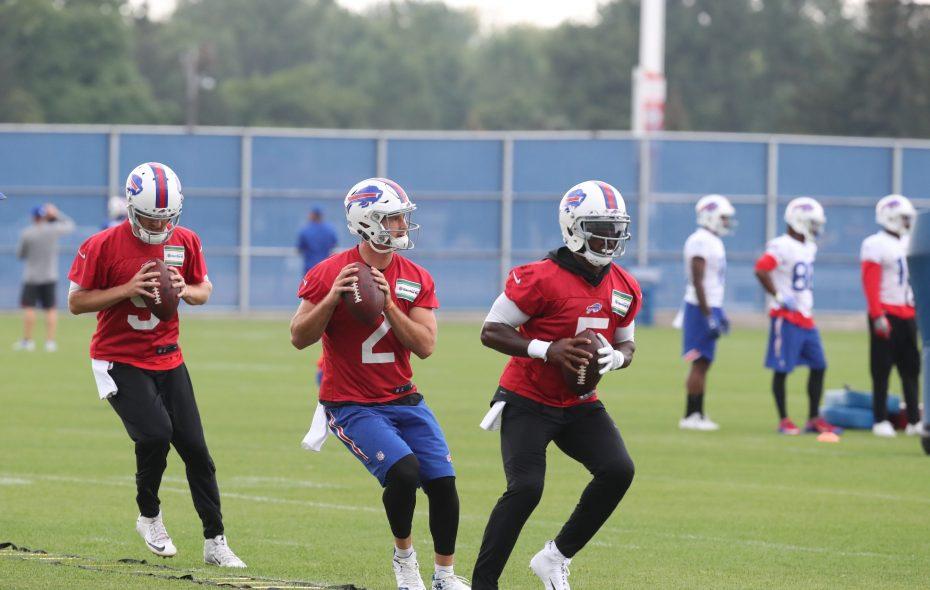 Buffalo Bills quarterbacks T.J. Yates, left, Nathan Peterman and Tyrod Taylor run foot drills during practice Tuesday at AdPro Sports Training Center in Orchard Park.  (James P. McCoy/Buffalo News)