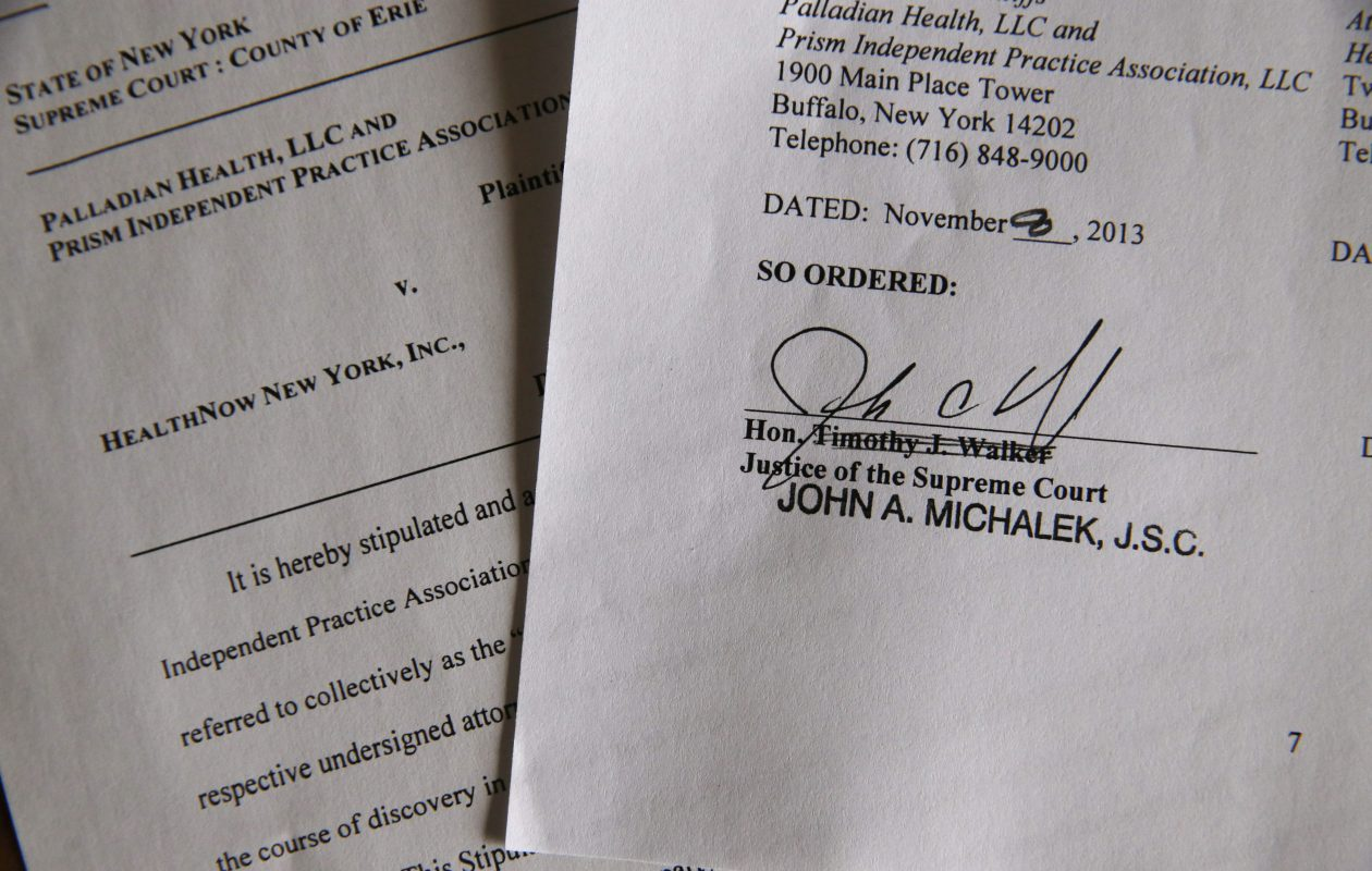 A court document from a case between Palladian Health and Prism Independent Practice Association and HealthNow New York signed by Judge John A. Michalek in 2013.   (Derek Gee/Buffalo News)