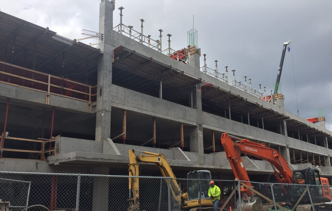 Work continues Thursday on new parking ramp on Ellicott Street on Buffalo Niagara Medical Campus. (Karen Robinson/Buffalo News)