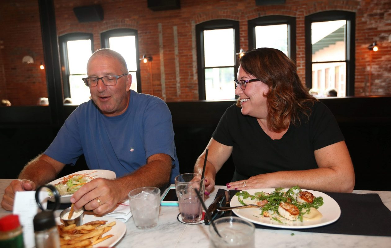 Rich and Laurie Greenspan of Williamsville have their dinner at the bar at Remington Tavern. Eating at the bar has more perks than you'd think. (Sharon Cantillon/Buffalo News)