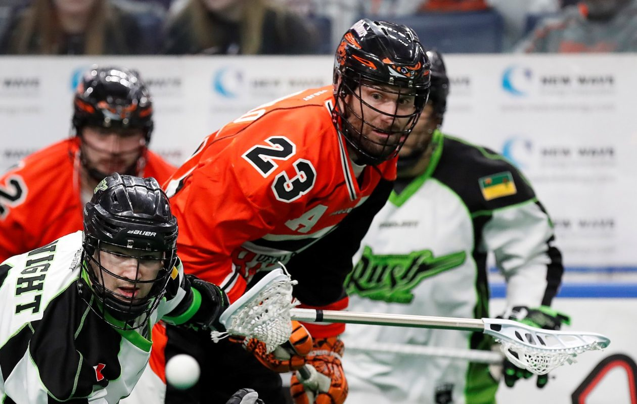 Buffalo Bandits Steve Priolo has the ball knocked away by  Saskatchewan Rush player Curtis Knight during first half action at the KeyBank Center on Saturday, April 1, 2017. (Harry Scull Jr./Buffalo News)