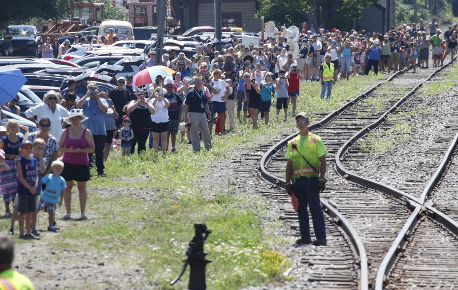 A crowd of spectators watch as the James E. Strates Shows train arrives at the Old Depot in Hamburg carrying all the wagons and amusement rides for the Erie County Fair Aug. 4, 2016.  (Photo by Derek Gee)