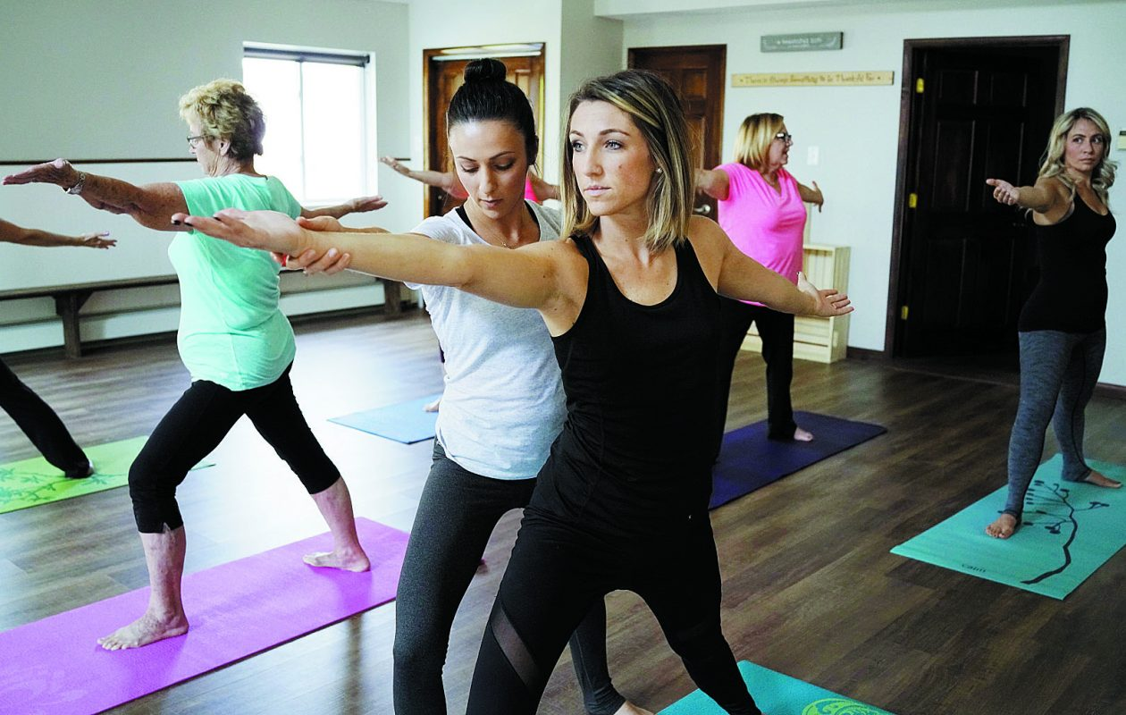 Teresa DeLabio, center-left, runs Holy Yoga at The Fountain Wellness Center in Clarence, the newest holistic wellness center in the region.  (Derek Gee/News file photo)