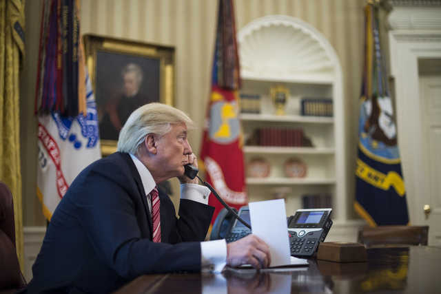 President Trump during a telephone call in the Oval Office. (Washington Post)