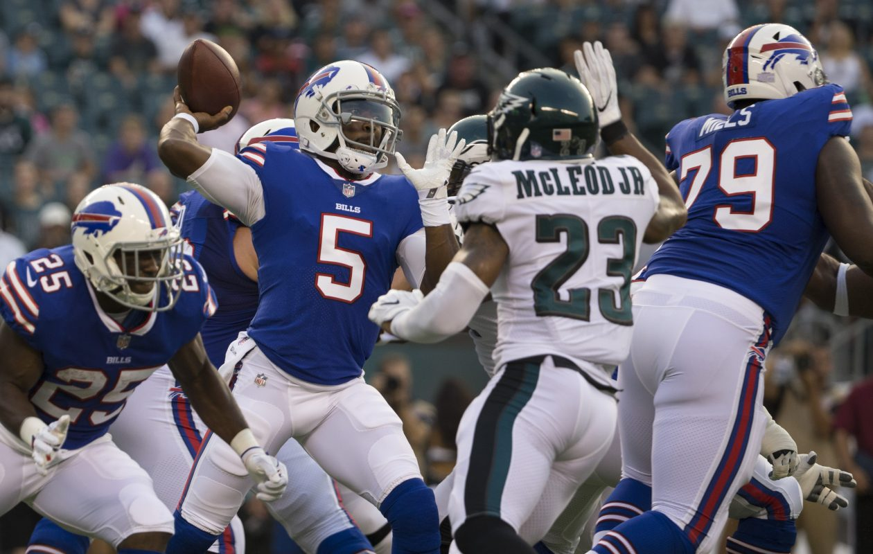 Bills quarterback Tyrod Taylor is about to have a pass deflected by Eagles safety Rodney McLeod, and intercepted, in the first quarter. (Mitchell Leff/Getty Images)