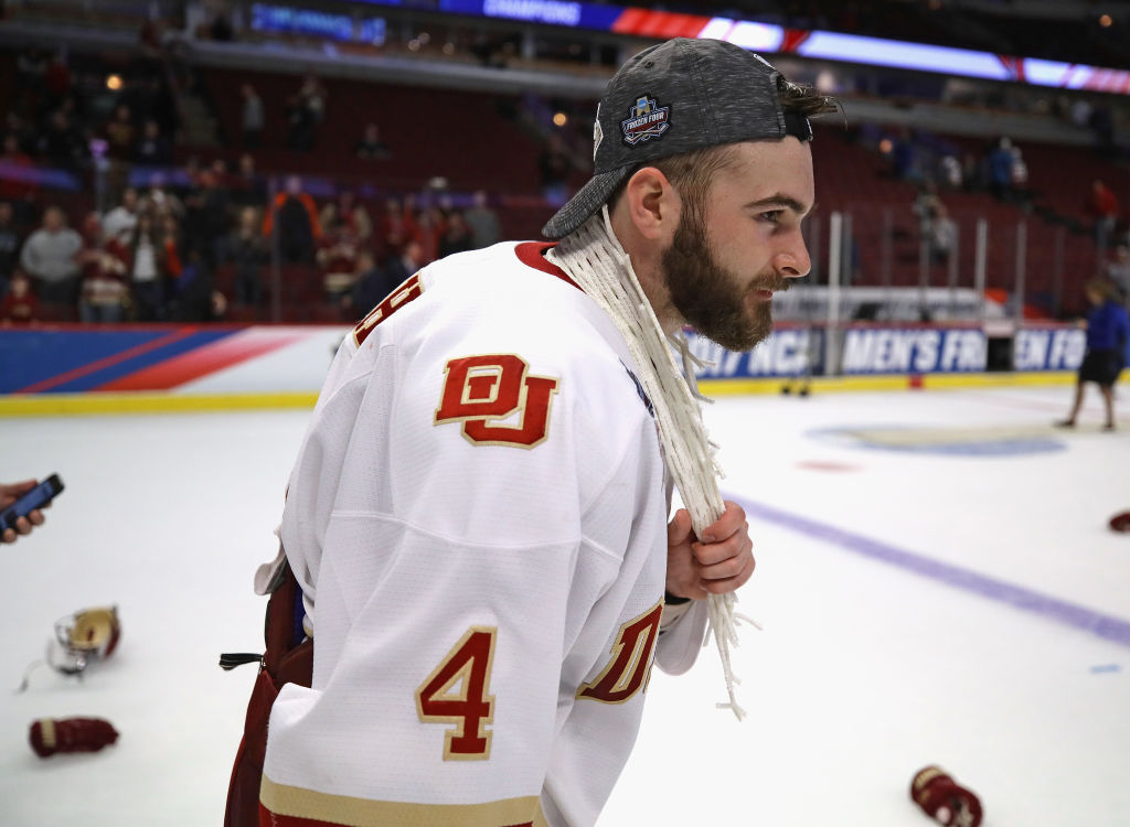 Denver captain Will Butcher wears a piece of the net after his team beat Minnesota-Duluth in the Frozen Four championship game in April in Chicago (Getty Images).