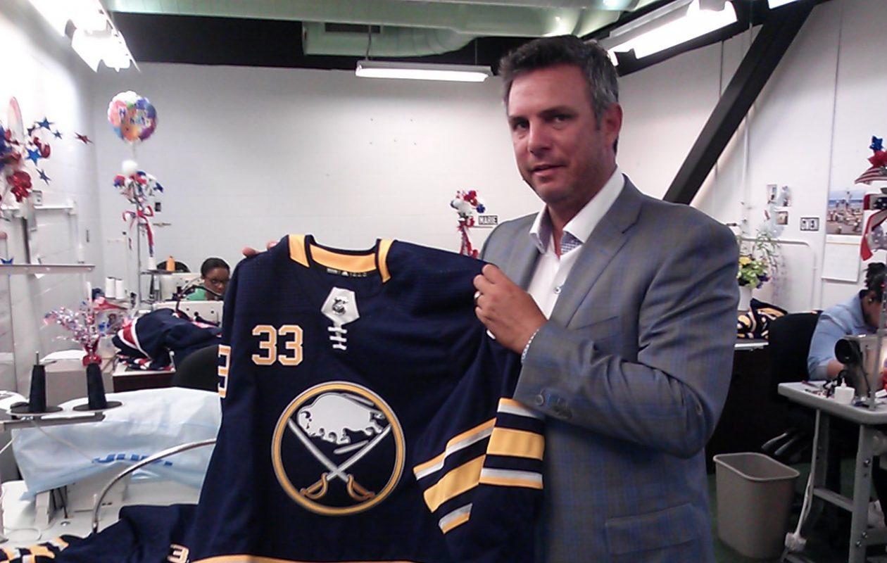 AdPro Sports president Ron Raccuia with a Sabres jersey at AdPro's Cheektowaga facility. (Matt Glynn/Buffalo News)