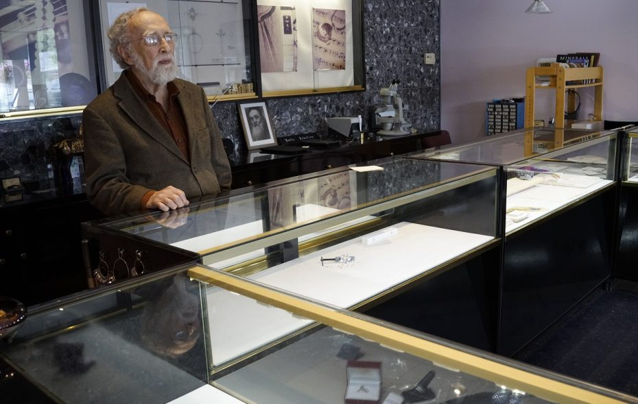 Joel Jaffe, owner of Amherst Jewelry, stands at his counter behind mostly-empty display cases. His Transit Road store was burglarized last month.  (Derek Gee/Buffalo News)