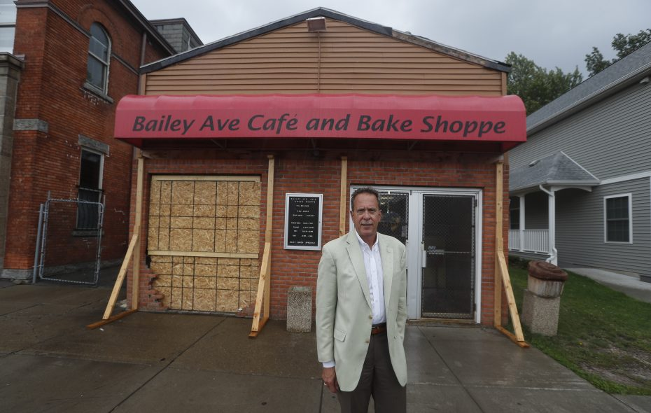 Rev. Terry King stands in front of the boarded up  Bailey Avenue Café & Bake Shoppe, 2021 Bailey Ave. on Tuesday Aug. 22, 2017.  (John Hickey/Buffalo News)