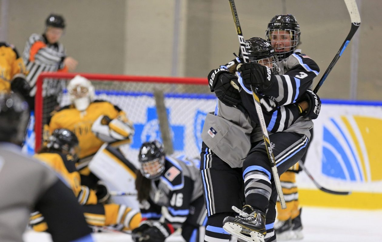 Buffalo Beauts' Kelley Steadman celebrates her second goal against the Boston Pride with Kelly McDonald at the HarborCenter on Sunday, Oct. 25, 2015.  (Harry Scull Jr./Buffalo News)