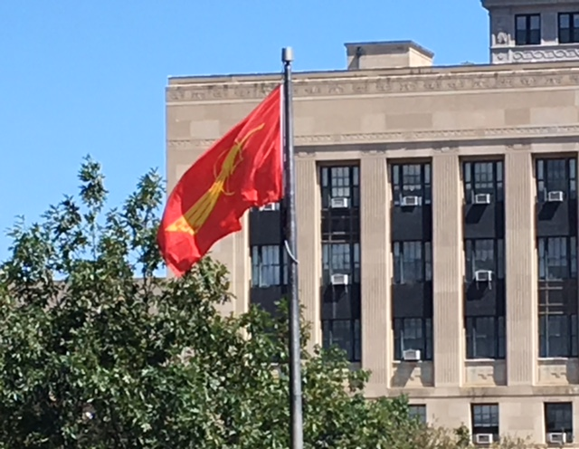 Flag symbolizing protests on the streets of Burma flies outside City Hall.