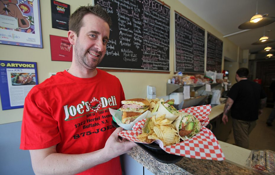 Joe Lyons, owner of Joe's Deli on Hertel Ave. in Buffalo, shows off a Sweet Baby James Wrap.  (Robert Kirkham / Buffalo News file photo)