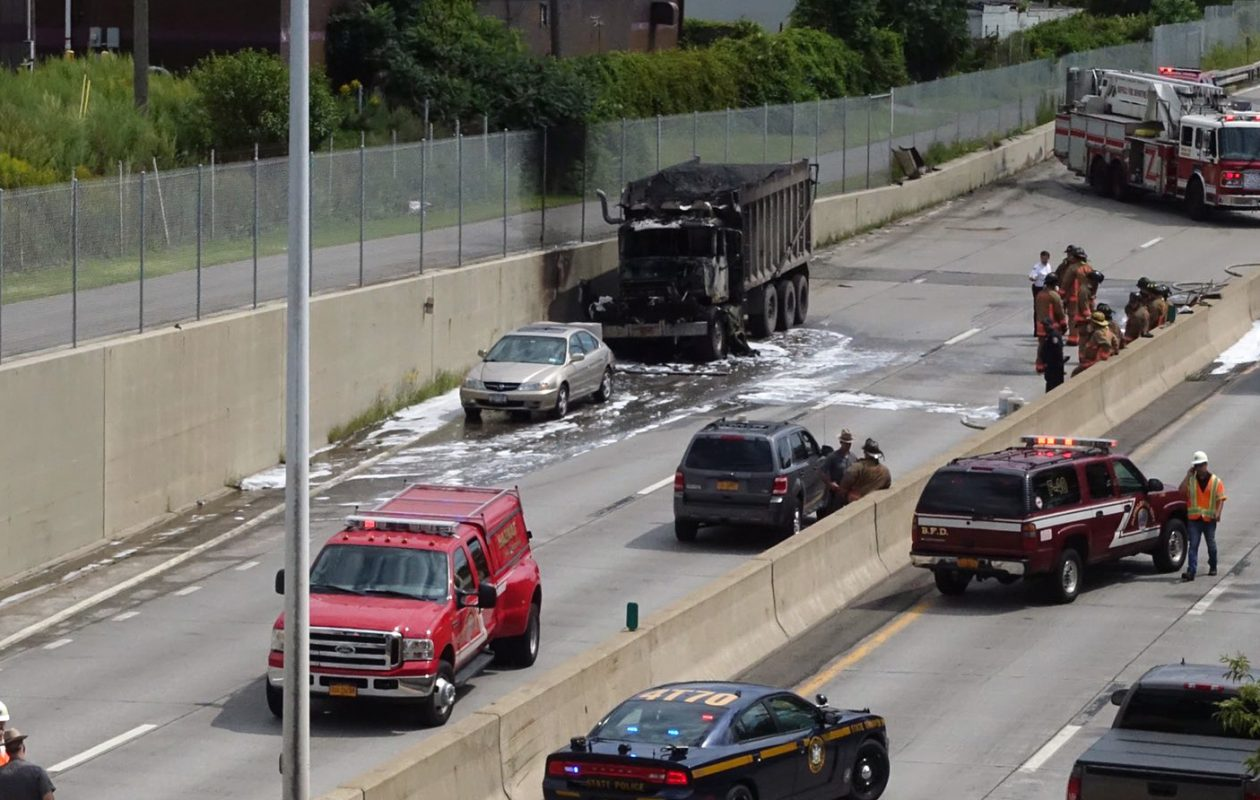 The scene after Buffalo firefighters put out a fire on a dump truck on the northbound Niagara Thruway. (John Hickey/Buffalo News)