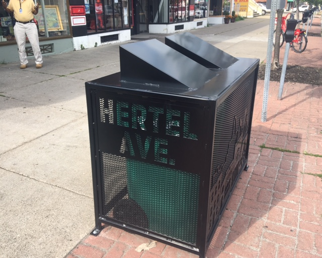 One of the 27 new artisan-crafted refuse tote corrals being installed on Hertel Avenue this week.
