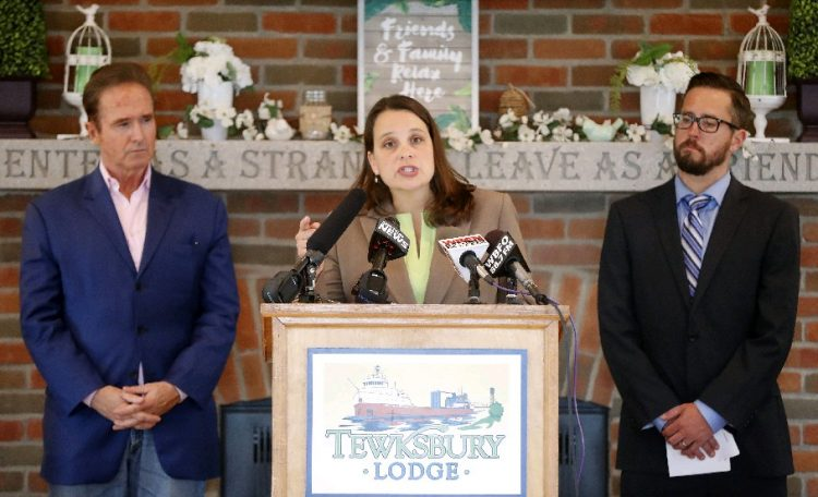 """Buffalo Niagara Riverkeeper Executive Director Jill Jedlicka speaks between Rep. Brian Higgins, left, and Brian Smith, Associate Director for Citizens Campaign for the Environment, right, during a rally to """"Save the EPA"""" Tuesday at the Tewksbury Lodge on Ohio Street.  (Mark Mulville/Buffalo News)"""