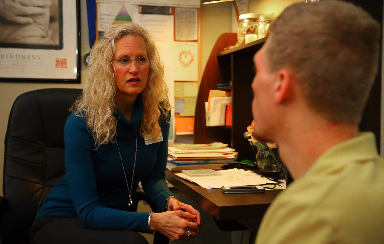 """If you can't think differently about your role in the lives of patients, you're never going to change the way you're practicing medicine."" – Jennifer M. Carlson, director of clinical operations, shown consulting with Alec Peinkofer, an insurance specialist, at Sheridan Medical Group (John Hickey/Buffalo News)"