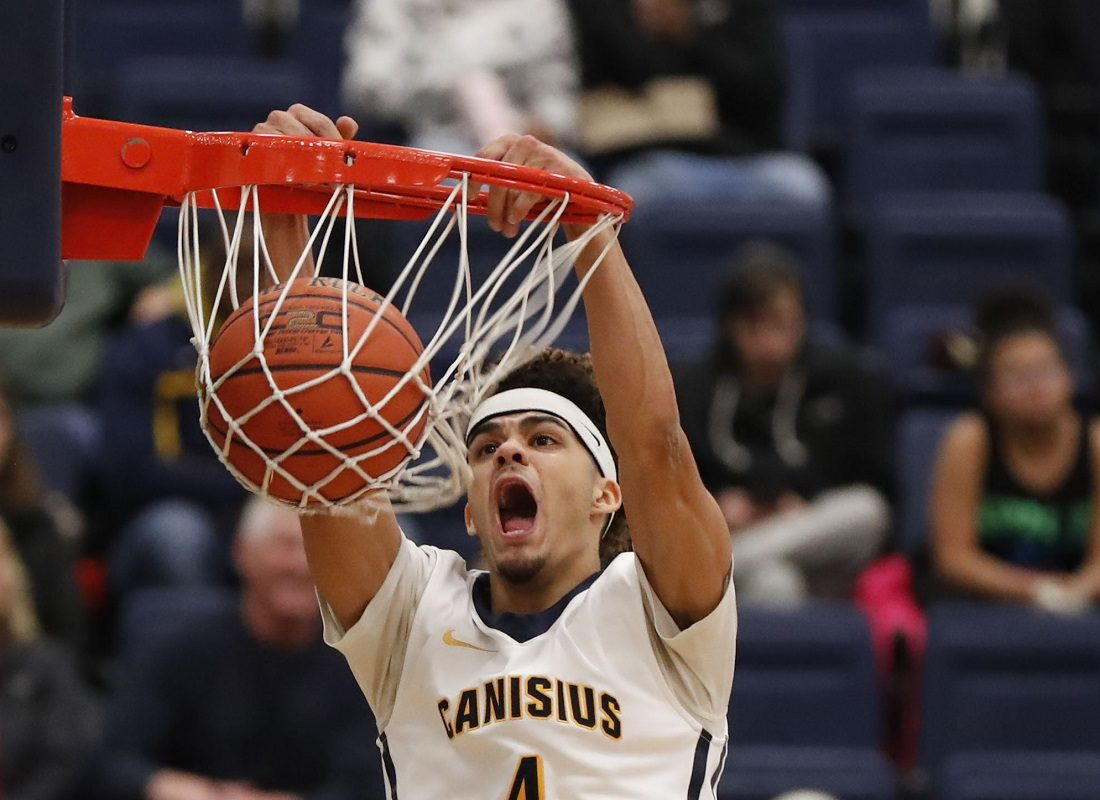 Canisius's Kiefer Douse dunks against Quinnipiac during first half action at the Koessler Athletic Center on Wednesday, Jan. 4, 2017. (Harry Scull Jr./Buffalo News)