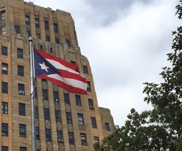Puerto Rican flag flies in Niagara Square for upcoming Puerto Rican and Hispanic Day Parade in Buffalo.