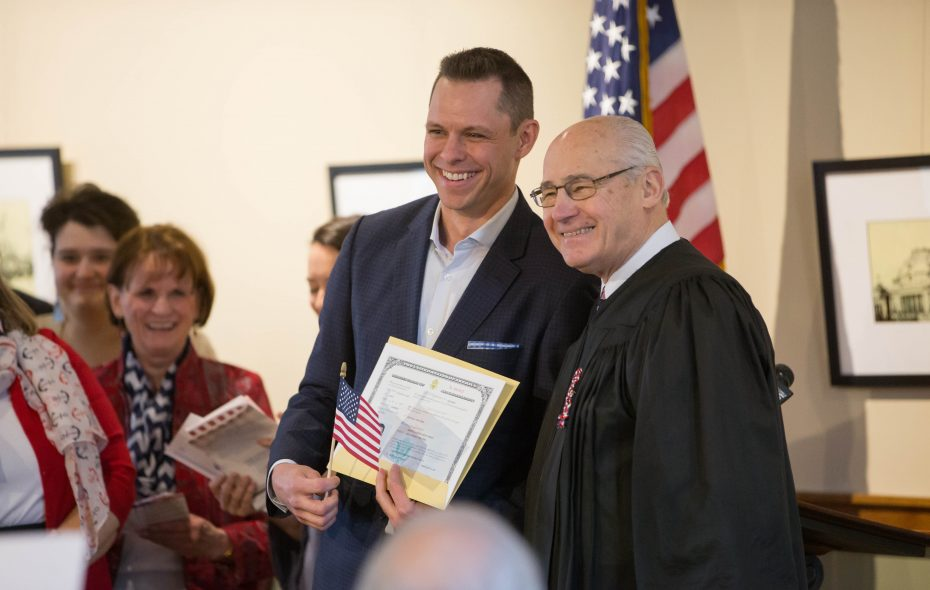 Martin Biron, with U.S. District Judge Leslie G. Foschio during a Presidents Day Naturalization Ceremony in February, has always had the gift of gab. (Derek Gee/Buffalo News)