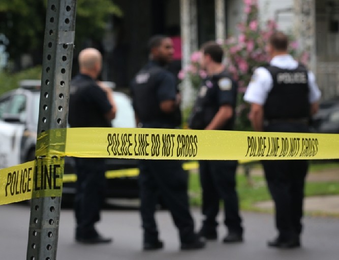 Police complain that they investigate crimes like this Detroit Street fatal shooting and often make arrests, but that  judges release suspects too easily – something judges say is not their fault. (Derek Gee/Buffalo News)