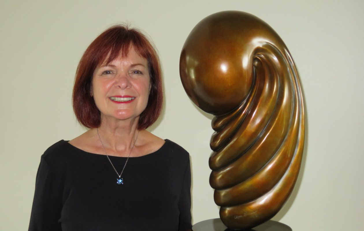 Rose Popper explains that her sculptures -- like this one, 'Evolution' -- are inspired by nature. [Photo by Guy Miller.]