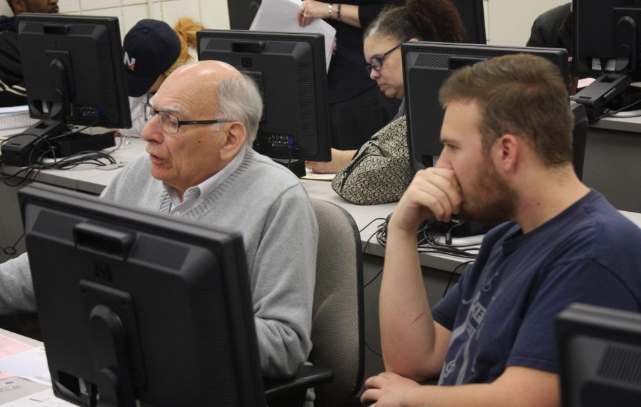 Volunteers at CCCS help others prepare taxes in 2016. (Contributed photo)