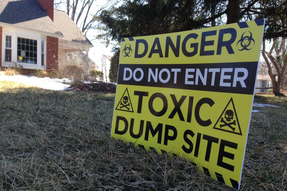 Signs like these warning of environmental dangers were posted by residents of Forbes Street in North Tonawanda in March 2017. (T.J. Pignataro/The Buffalo News)