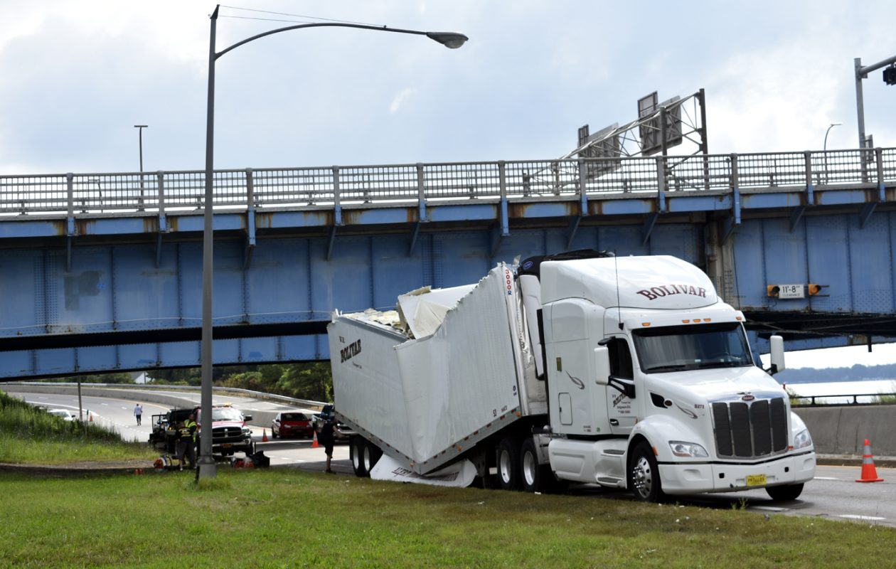 A tractor-trailer driver tried to squeeze under the north Grand Island bridges in Niagara Falls on Wednesday morning.  (Larry Kensinger/Special to the News)