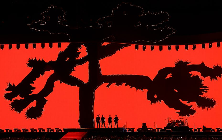 Members of U2 stand against the backdrop of the Joshua Tree during a show at BC Place in Vancouver. (Getty Images)