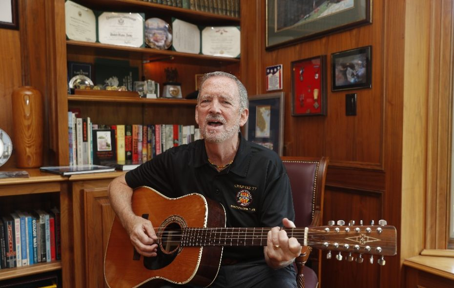 Vietnam War veteran Norm Murray played his guitar during quiet moments in between interrogating POWs to glean life-saving information. Now he does concert fundraisers to build the Education Center at The Wall in Washington, D.C.  (John Hickey/Buffalo News)