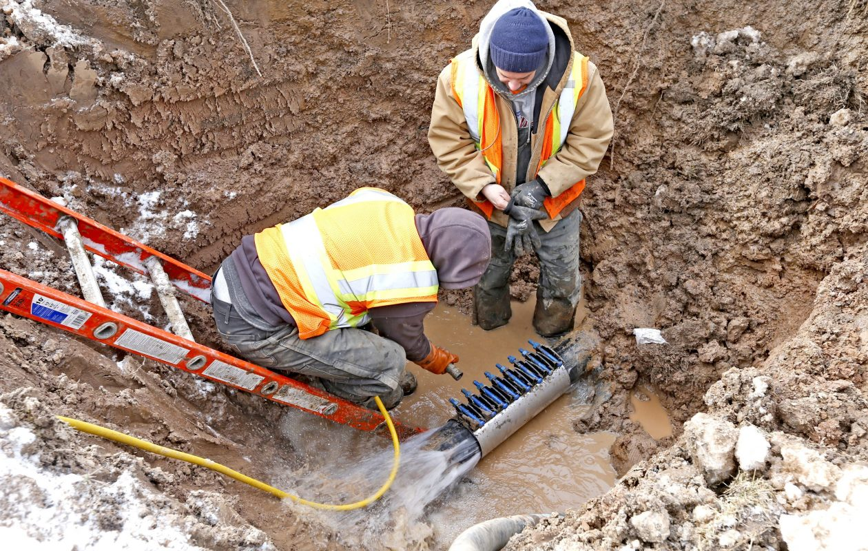 An Erie County Water Authority utility crew repairs a ruptured water supply pipe in Amherst after extreme temperatures caused the cast iron pipe to fracture.   (Robert Kirkham/Buffalo News file photo )
