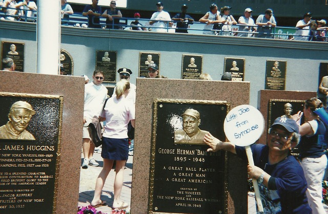 Joe Enriquez with the monument to Babe Ruth, Yankee Stadium. (Image courtesy Kathi and Bill Connor)