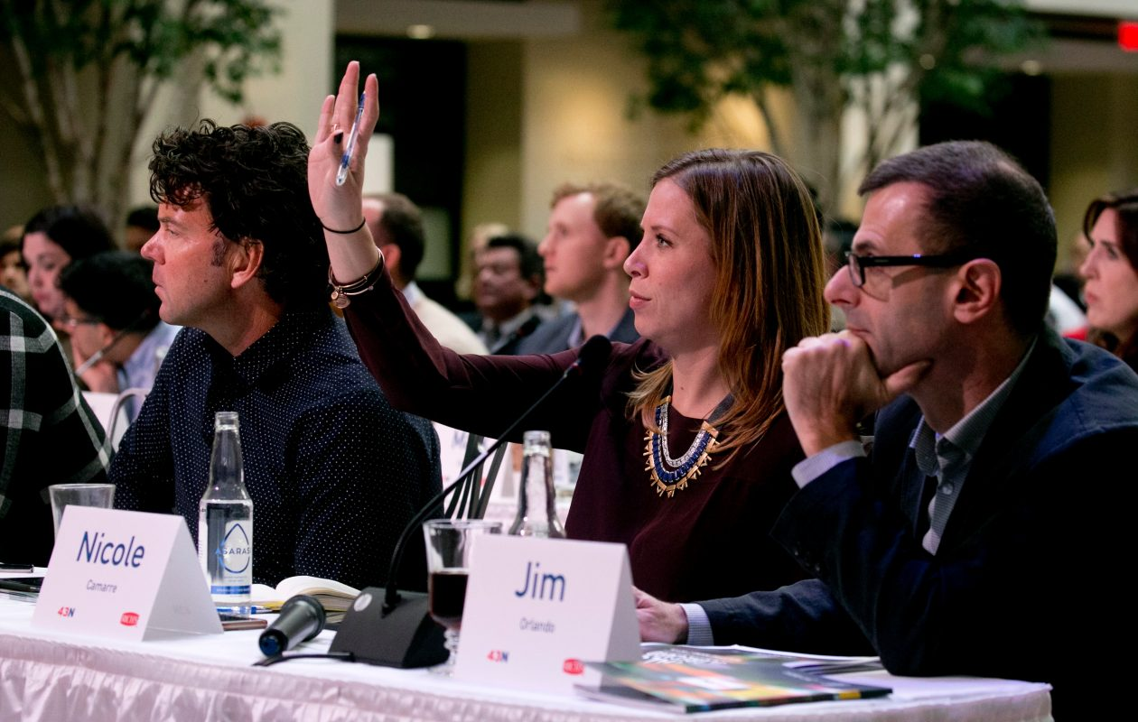 Nicole Camarre from  Armory Square Ventures raises a hand to ask a finalist a question at last year's 43North competition, where she served as a judge.   (John Hickey/Buffalo News file photo)