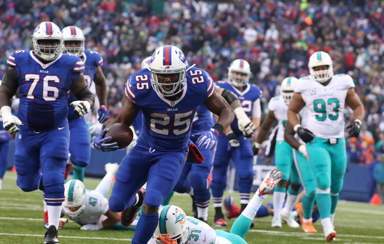 Bills running back LeSean McCoy (25) beats Miami for a touchdown at New Era Field last season, when they finished third in the NFL for scoring at home.  (James P. McCoy/News file photo)