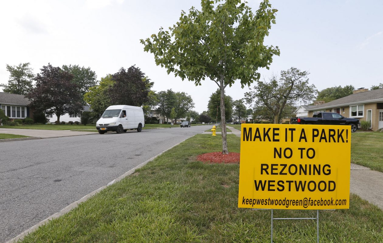 Residents post their dislike of the proposed project near the old Westwood Country Club on North Forest Road in Amherst on Friday, July 21, 2017. (Robert Kirkham/Buffalo News)