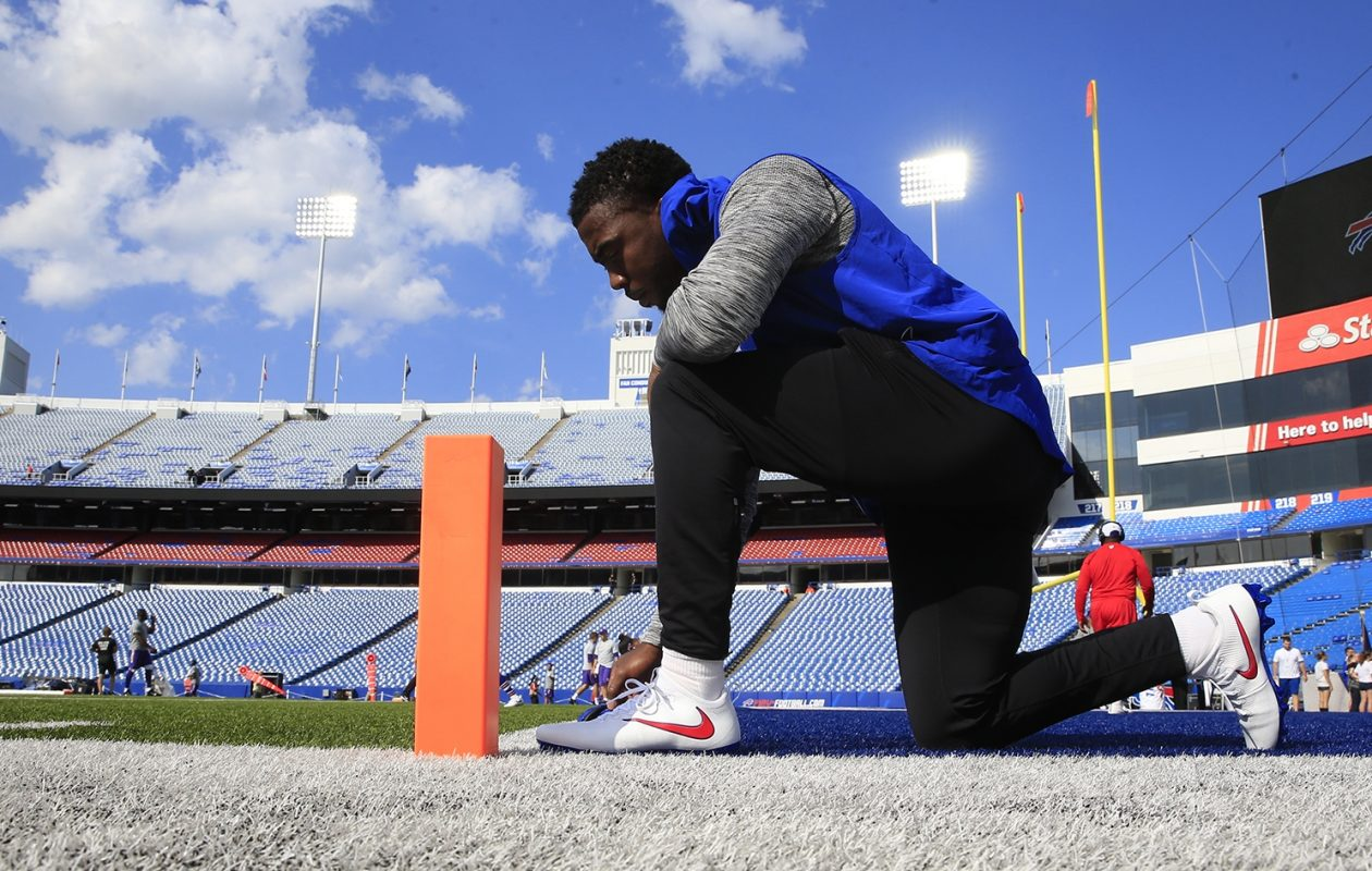 Bills quarterback Tyrod Taylor rests on a knee during warmups. (Harry Scull Jr./Buffalo News)