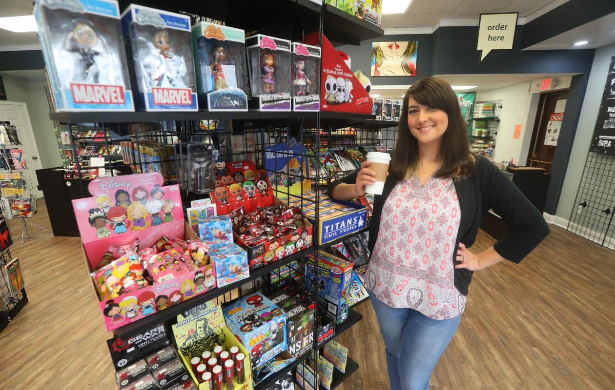 Amy Berent in her shop at Pulp 716 Coffee and Comics at 31 Webster St., North  Tonawanda., on  Tuesday,  Aug. 29, 2017.   (John Hickey/Buffalo News)