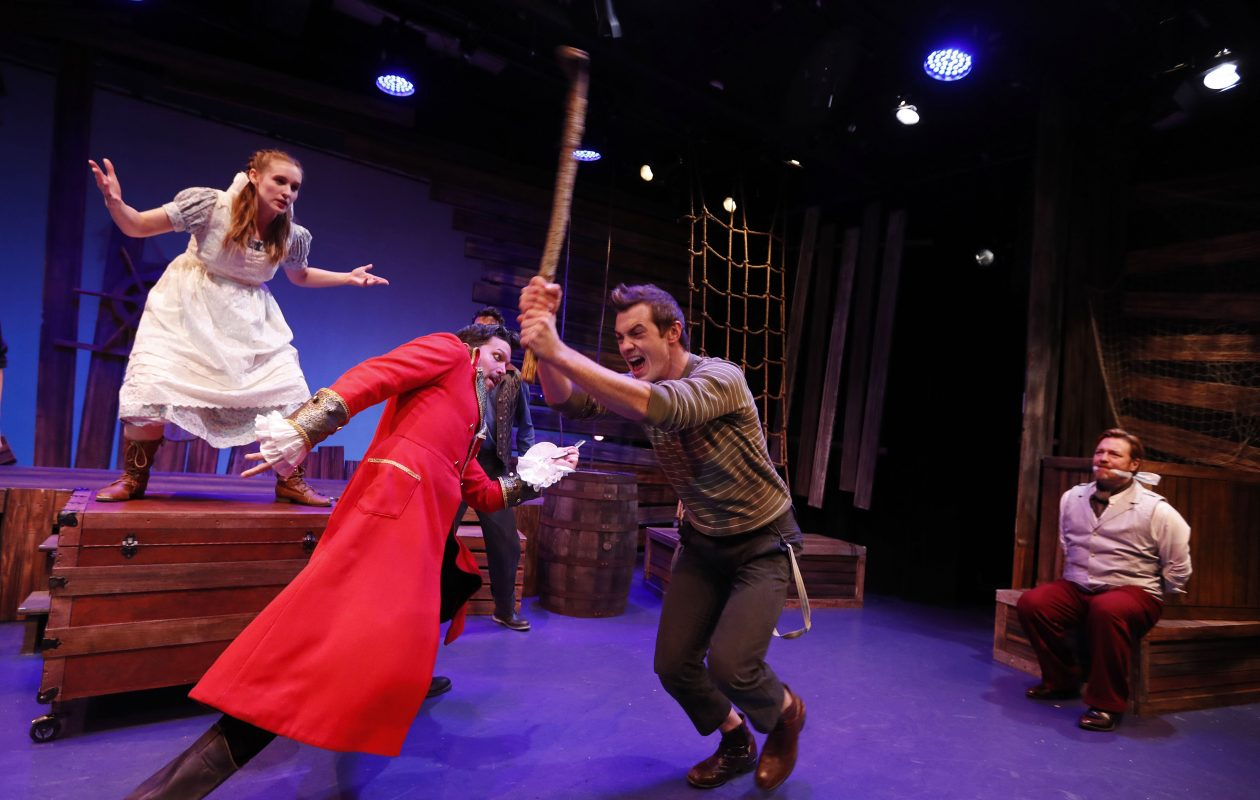 """Steve Copps, left, as Black Stache and Jessie Tiebor as Peter battle it out in """"Peter and the Starcatcher"""" at MusicalFare Theatre.  (Mark Mulville/Buffalo News)"""