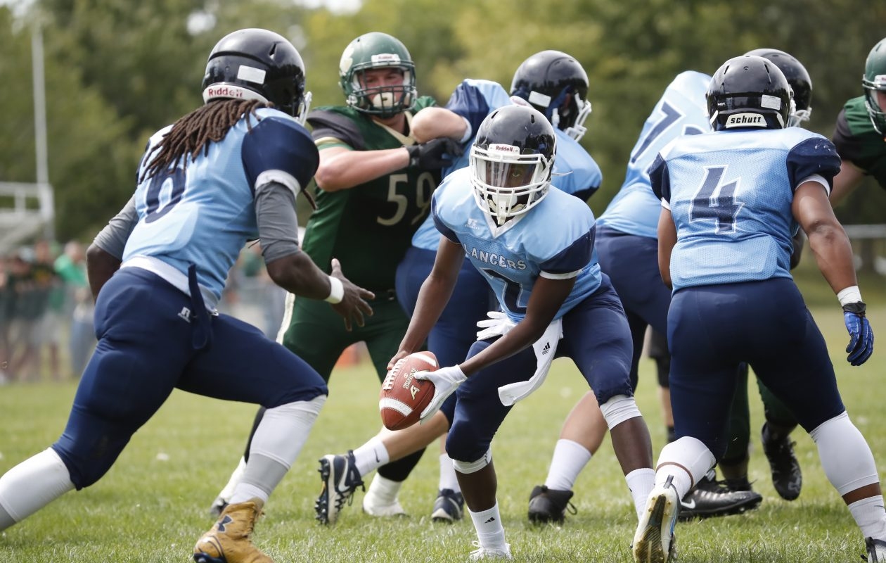 St. Mary's D'Jae Perry receives the pitch from quarterback JaShawn Collins during a recent game against Bishop Timon-St. Jude. Perry had a great day in leading the Lancers to a win last Saturday over Bishop Kearney of Section V. (Harry Scull Jr./Buffalo News file photo)