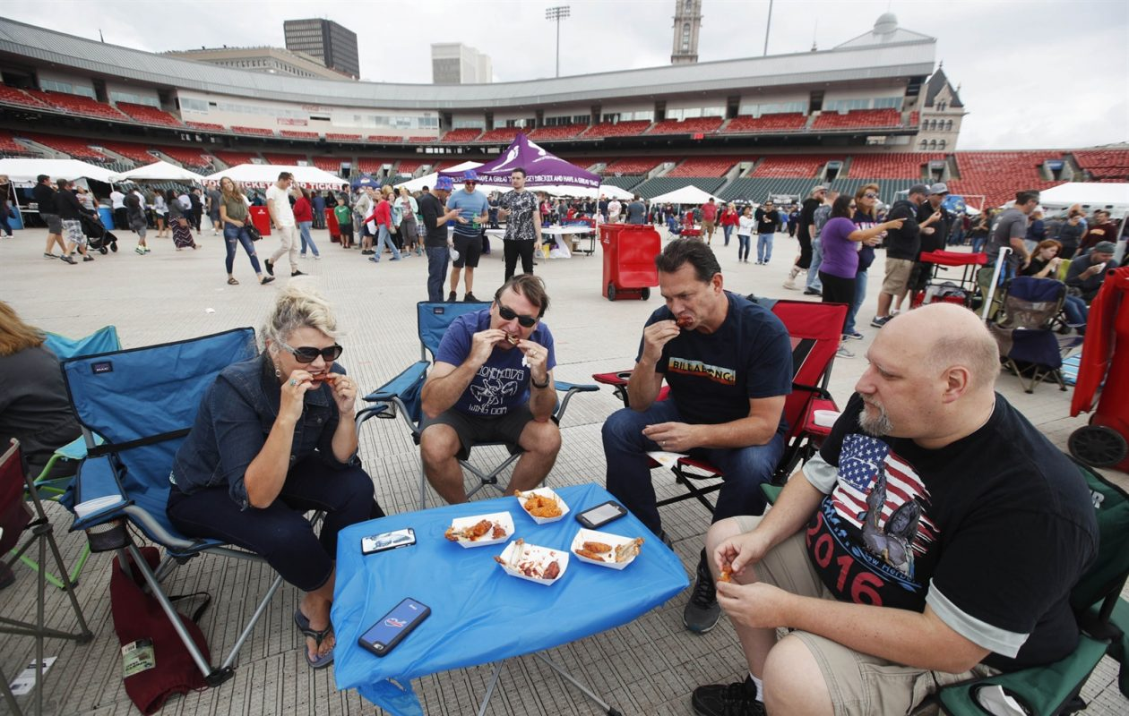 Hanging out at the National Buffalo Chicken Wing Festival on Sunday, from left, are Stacy and Norman Kranz, of Hamburg; Scott Wagner, of Lakeview; and Mike Mosscrop, of Buffalo. (Sharon Cantillon/Buffalo News)